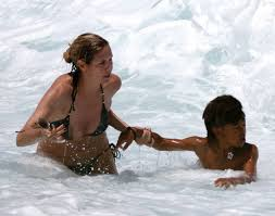 a few weeks ago, the model heidi klum rescued her seven year old son henry from a riptide off the coast of the hawaii island where the family vacationed.  i would jump right in the water too if my son's life was in danger. . . of course, i wouldn't look as great!
